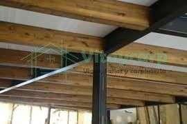 Estructura metálica con vigas de madera para forjado